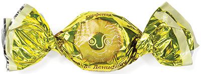 Конфета Ананас Денисович в белой шоколадной глазури используемая в новогодних подарках